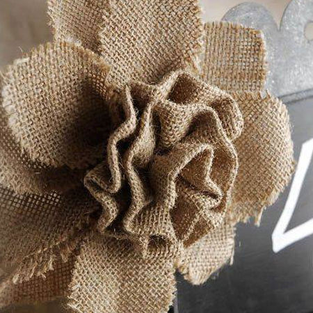 Use burlap scraps to make shabby roses for your cushions.