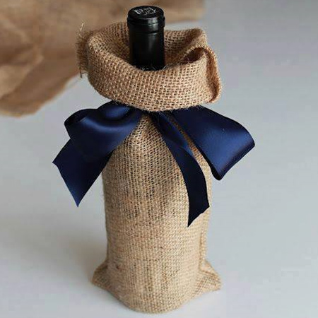 Just in time for the festive season... use burlap to wrap gifts that have an awkward shape such as wine bottles. Finish off with a satin ribbon