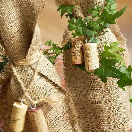 Just in time for the festive season... use burlap to wrap gifts that have an awkward shape such as wine bottles. Decorate with wine corks