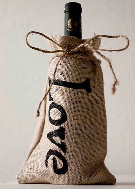 Just in time for the festive season... use burlap to wrap gifts that have an awkward shape such as wine bottles. Add a stencilled logo or wording