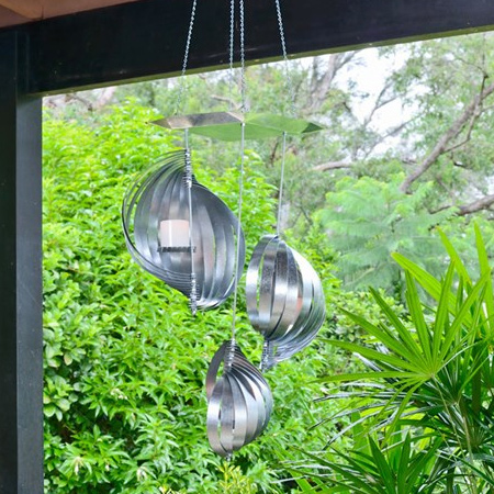 This DIY sculptural metallic chandelier will add a soft evening glow to your patio, deck or entertainment area.