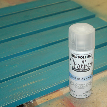 After wiping clean, shake the can before applying Rust-Oleum Matte Clear Coat over the painted surface. This offers protection for the table top.