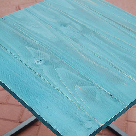 The steel frame table top finished with Rust-Oleum Chalked spray paint in Tidal Pond.