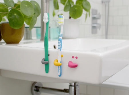 Free up some space around the bathroom basin with these handy smiley face toothbrush holders. Sugru is waterproof and bonds brilliantly to ceramics and metals, so you can easily install hooks, towel rails and toilet roll holders directly onto your tiles without any drilling