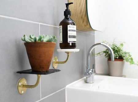 Bathroom fittings usually have 2 parts: the mounting bracket and a nice chrome part. Now you can use Sugru instead of drilling into walls, making this job a whole lot easier. In 24 hours, you'll be ready to use your shelves for setting the mood with candles and plants, or for keeping essential bathroom stuff handy