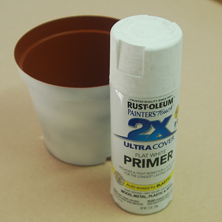Spray all the pots with a primer coat