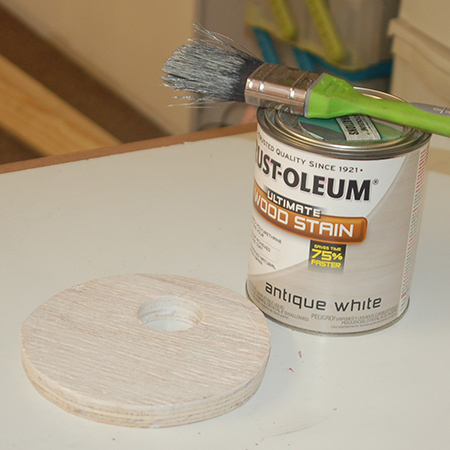 use a paintbrush to apply the stain