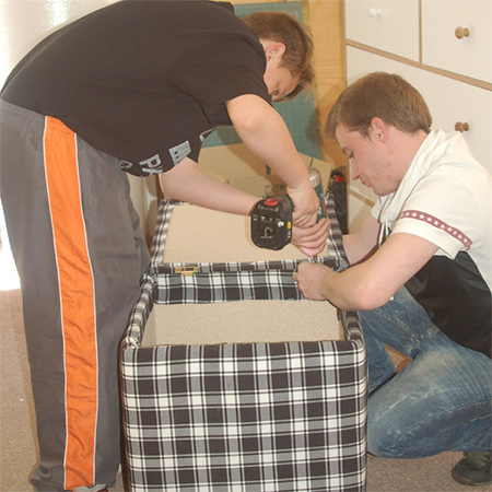 the DIY Kids Jamie and Jessie learned how to make an upholstered storage ottoman using a Drill / Driver and Bosch Tacker
