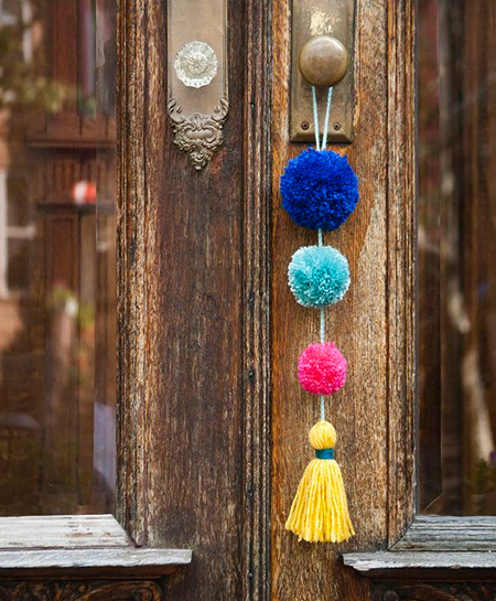 Colourful pom-poms are an inexpensive way to add a fun element to your home decor. You don't need special skills to make pom-poms and you can make them in a variety of sizes.