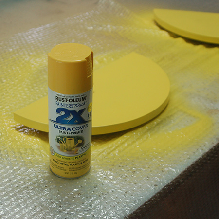 4. Sand all the cut edges with 120-grit sandpaper before putting down newspaper or a drop cloth and spraying with Rust-Oleum 2X spray paint in your choice of colours.