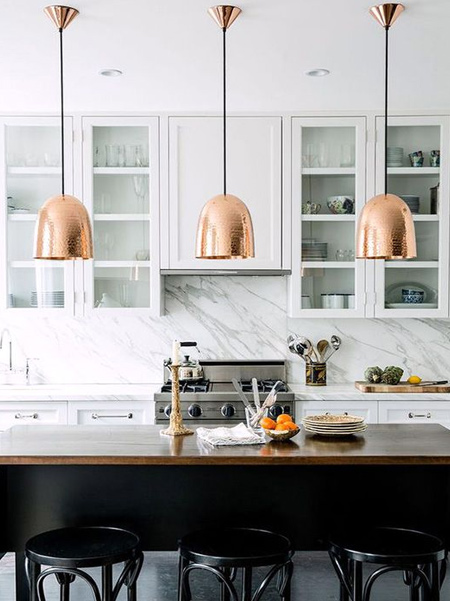 Incorporate the warm hues of rose gold, brass and copper to add a homely luxury. They're best added as accents such as pendant lights, small appliances, cupboard door handles and kitchen gadgets. These metallics pair particularly well with white, black, blue and grey and many cabinet colours.