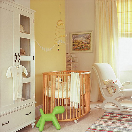 In a small nursery where you want to introduce wood furniture, look for pieces that are made of light coloured timber, as these won't make the room feel cramped and dark