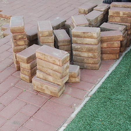 GOOD TO KNOW: If you are going to be re-using the paving bricks, clean them off and stack neatly to one side.