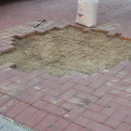 After removing all the paving bricks, soil is packed into the area to level it out. This then needs to be compacted using a manual or mechanical tamper. For a small area you can tamp down the area using a heavy hammer, but it is recommended that you hire a mechanical tamper for larger areas.