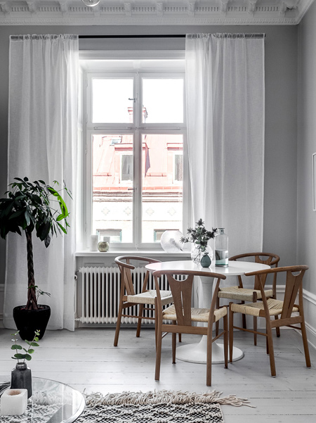 Simple sheer or voile window treatments add a soft touch to modern or traditional room settings.