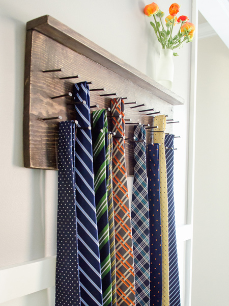 Use offcuts or pieces of reclaimed wood to make a tie or belt rack for your closet, or to mount on a closet door. You can add as many nails (or screws) as you need to your accessories