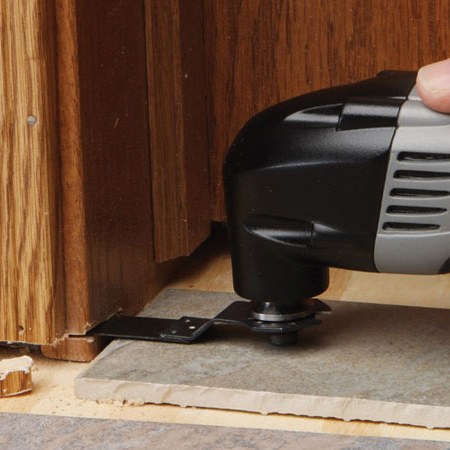 When you need to trim a door or frame so new flooring will fit, a multifunction tool is ideal for the job. Use a flush-cutting wood blade attachment.