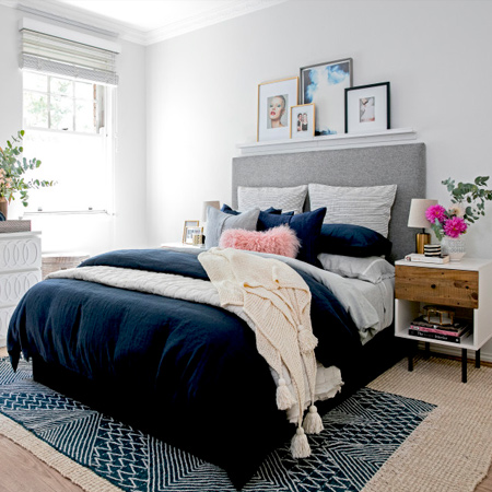 A blah bedroom turns into a grown up sanctuary with navy and gold accents. If your bedroom is in need of a makeover, take inspiration from this project.
