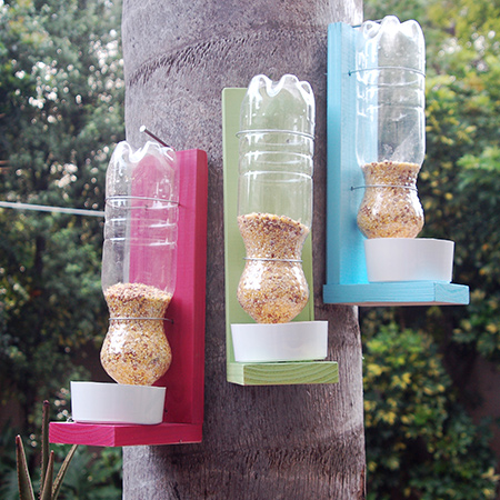 Use scraps of wood, Rust-Oleum 2X spray paint and recycled plastic bottles to make these colourful bird feeders.