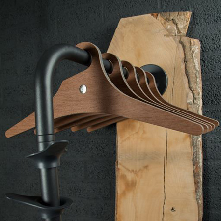 The RiZZ coat rack incorporates a reclaimed wood panel, Wenge-plated hangers and stainless steel fittings with powder coating in anthracite.