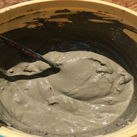 Mix the cement into a smooth consistency - it shouldn't be too runny or too stodgy. Aim for a porridge or thick cream consistency