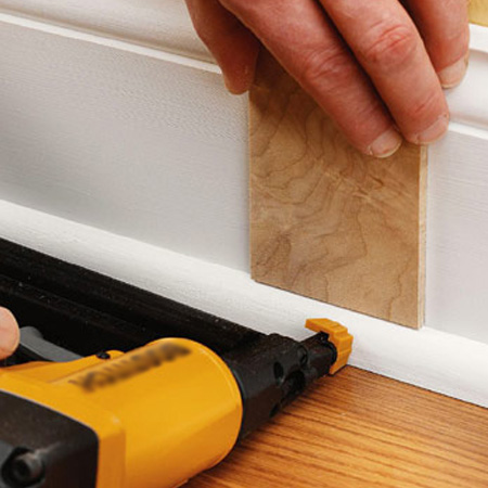 Use a brad nailer to build up decorative layers when mounting skirting boards or window trim.