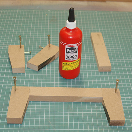 1. The front back and sides are joined to the legs with wood glue and screws.