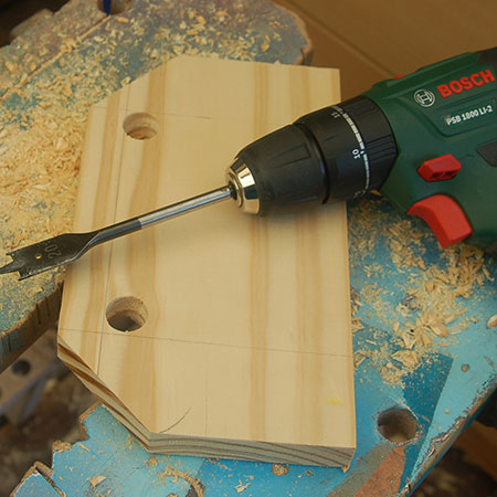 4. Drill two holes with a 20mm spade bit.