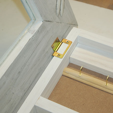 BELOW: Frame attached to cabinet / box frame with butt hinges.