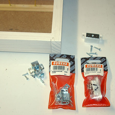 HOME-DZINE | Eureka DIY products - secure a door catch to the frame and cabinet / box frame. For this project a double roller catch was used, but you can just as easily use a magnetic hinge catch. Eureka have a selection of door fastenings.