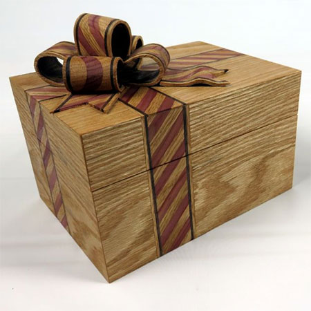 HOME-DZINE | Gift Ideas - This box is so beautiful, the box itself is a gift. The box shown here is made using Red Cedar, Oak and Walnut. With it's inlay of Cedar and Oak, the ribbon detail adds a wonderful finishing touch to a piece that lends itself to becoming a heirloom piece that can be passed down.