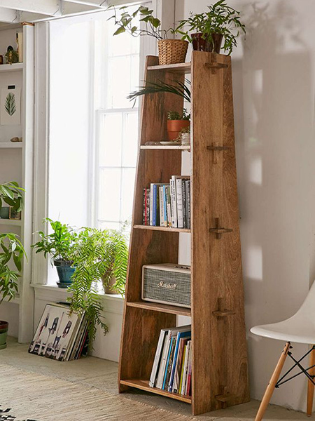 Use laminated pine shelving to make this wooden bookcase. The unit assembles easily and can be taken apart in a jiffy.