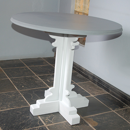The pedestal table is painted in shades of grey - a light grey on the base and dark grey on the top - in Prominent Paints Premium Satin Silk.