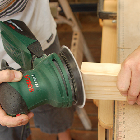 1. Use a sander to round off the edges that will form the top and base of the pedestal. Sand away any rough edges on all pieces.