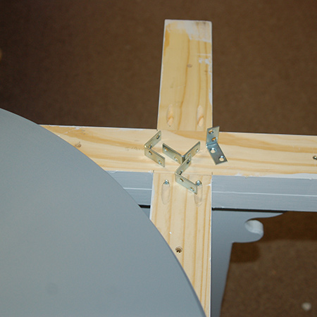 13. Attach the tabletop to the base with steel angle braces and screws.