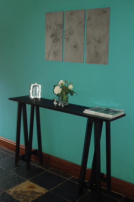 Use laminated pine shelving and pine planks to make a Trestle Console Table in a jiffy that will cost around R300!