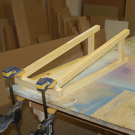 3. Use wood glue to secure the legs to the top crosspieces - at the 5-degree angled cut. Clamp overnight.