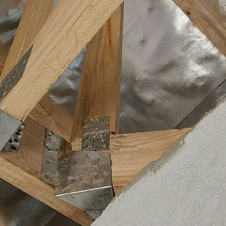 Sometimes, installers will start loading the roof tiles before the structure has been inspected, which can have damaging results. In complex roofs where bracing and metalwork can easily be installed in the wrong positions or neglected, long compression truss members can buckle and tension members can pull out of nail plates