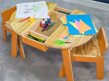 This child-sized play and craft table will inspire creativity. Featuring work and storage space and chairs that are just the right size. Use a ready-made top and ad a few angles and gentle curves for style.
