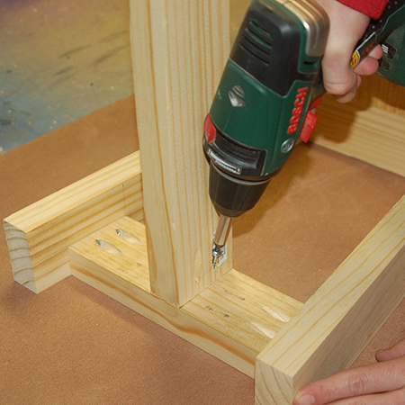8. Use wood glue and pockethole screws to secure the top and bottom rails to the sides.