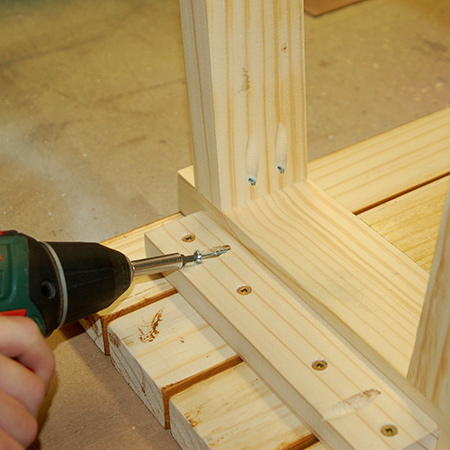 9. Place the bench face down on the slats in order to mount the bottom frame to the underside of the seat slats