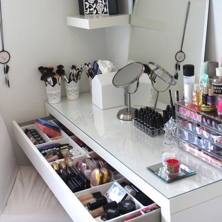 A large pull-out drawer is all that's needed to provide easy access to your makeup collection. Use containers to corral and organise lipstick, eye shadow and nail polish.