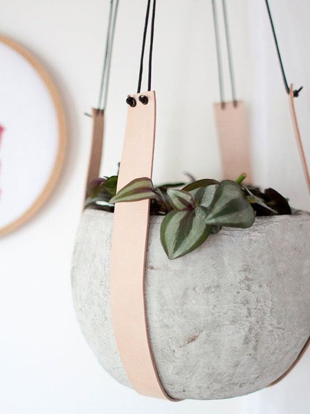 If you don't consider yourself very handy but like the look of macrame hangers, look at materials that can be used as an alternative so that you don't have to do any knots, like a  leather plant hanger