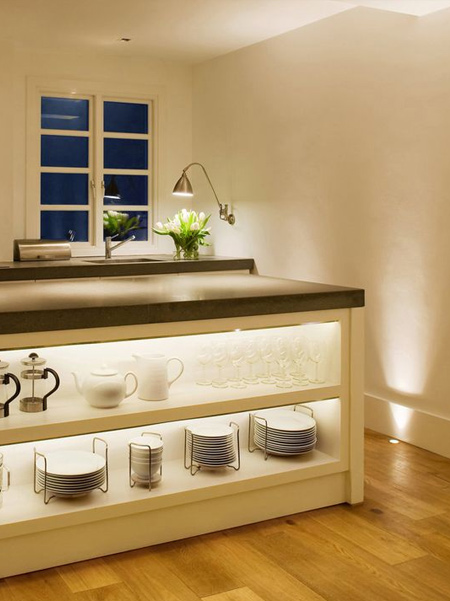 LED strip lights offer an inexpensive way to add lighting design to a kitchen and can be mounted discretely above cabinets or to light cabinet countertops.