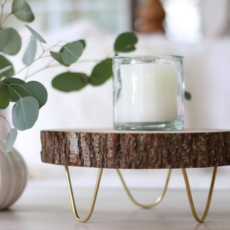 With wood slice and wire you can make your own decorative trivets or stands for a variety of items - and they look wonderful when used as decor pieces.