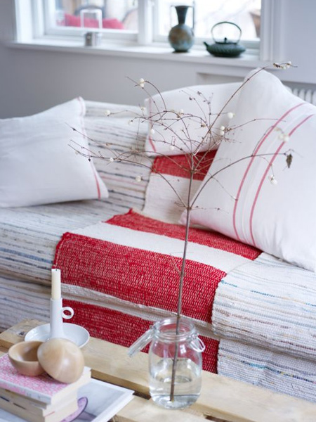 red and white textiles, wooden furniture and minimal decoration