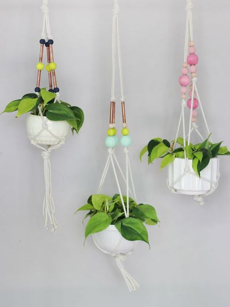 Macrame is a super-easy way to craft your own plant hangers. When making macrame plant hangers you can work with nylon line, sisal rope, cotton string, T-shirt yarn, or any other material that can be knotted.