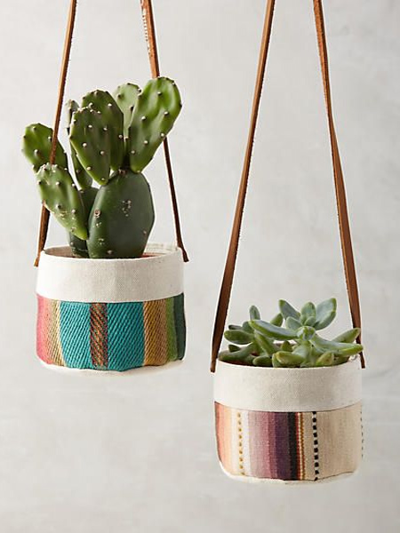 Colourful fabric scraps are sewn together to make fun containers for hanging plants