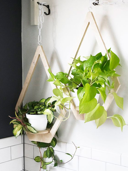 For those with the necessary tools and some basic DIY savvy, there are a variety of wood products that you can use to craft unique plant hangers. Love the plywood plant hangers shown - and so easy to make.