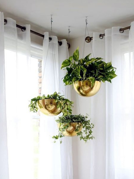 You wouldn't think that plastic bowls would make attractive plant holders, but give them a coat or two of Rust-Oleum Universal metallic spray paint and you have affordable planter hangers that look stunning.